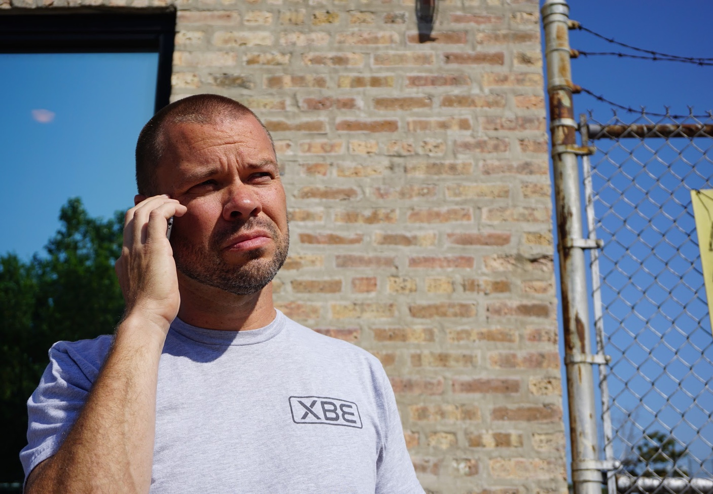XBE's CEO Sean Devine on the phone looking a bit grumpy